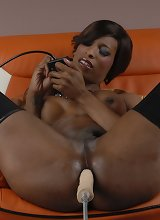 Black TS Natassia plays with a fuck machine