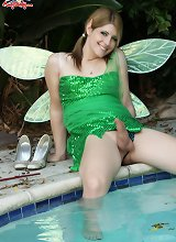 Amy the faerie strips by the pool