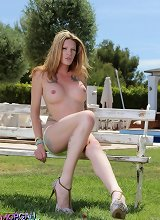 Long-legged beauty Morgan strips outdoors