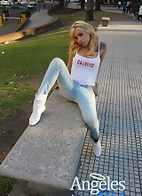 Sexy petite tranny Angeles Cid gets topless at a public park