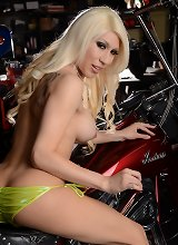 Gorgeous blonde Victoria posing on the bike