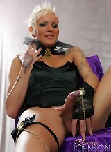 Sexy blonde tranny with a long curvy cock in black lingerie