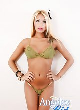 Sexy Blond Blue Eyed Shemale Angeles Cid taking off her green lingerie